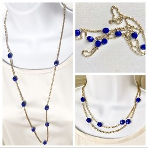 Gold necklace with faceted blue beads